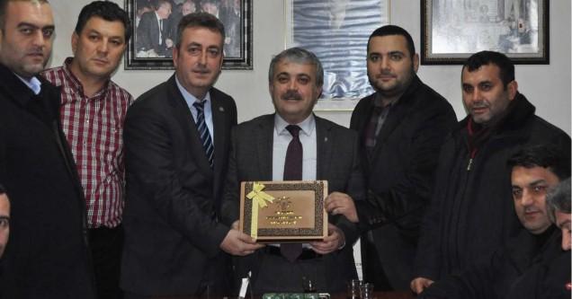 AK Parti'den Erhan Erdem'e kutlama